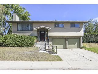 Photo 1: 12036 CANAVERAL Road SW in Calgary: Canyon Meadows House for sale : MLS®# C4069001