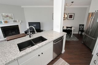 "Photo 17: # 213 2010 W 8TH AV in Vancouver: Kitsilano Condo for sale in ""AUGUSTINE GARDENS"" (Vancouver West)  : MLS®# V880530"