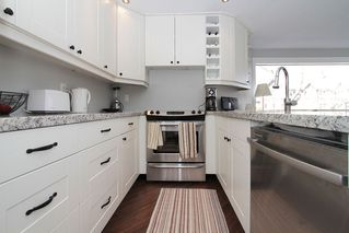 "Photo 28: # 213 2010 W 8TH AV in Vancouver: Kitsilano Condo for sale in ""AUGUSTINE GARDENS"" (Vancouver West)  : MLS®# V880530"