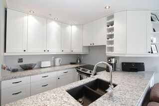 "Photo 25: # 213 2010 W 8TH AV in Vancouver: Kitsilano Condo for sale in ""AUGUSTINE GARDENS"" (Vancouver West)  : MLS®# V880530"