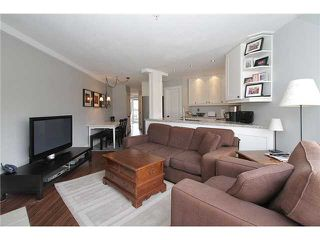 "Photo 9: # 213 2010 W 8TH AV in Vancouver: Kitsilano Condo for sale in ""AUGUSTINE GARDENS"" (Vancouver West)  : MLS®# V880530"