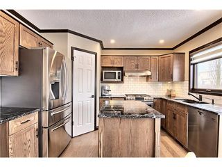 Photo 9: 10326 TUSCANY HILLS WY NW in Calgary: Tuscany House for sale : MLS®# C4109641
