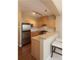 Photo 3: 108 2951 SILVER SPRINGS Boulevard in Coquitlam: Westwood Plateau Condo for sale : MLS®# V945866
