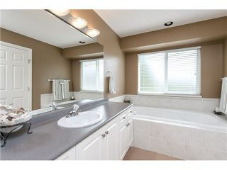 "Photo 11: 12090 237A Street in Maple Ridge: East Central House for sale in ""FALCON RIDGE ESTATES"" : MLS®# V1074091"