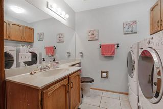 Photo 16: 44 Woodstock Way SW in Calgary: Woodlands Detached for sale : MLS®# A1039834
