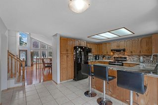 Photo 9: 44 Woodstock Way SW in Calgary: Woodlands Detached for sale : MLS®# A1039834
