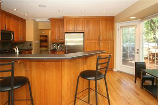 Photo 10: 1404 KERWOOD Crescent SW in Calgary: Kelvin Grove Detached for sale : MLS®# A1053643
