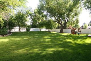 Photo 6: 1404 KERWOOD Crescent SW in Calgary: Kelvin Grove Detached for sale : MLS®# A1053643