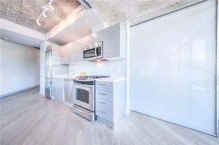 Photo 1: 319 Carlaw Ave Unit #415 in Toronto: South Riverdale Condo for sale (Toronto E01)  : MLS®# E3556672