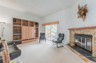 Photo 3: 18 Coachway GR SW in Calgary: Coach Hill House for sale : MLS®# C4179462