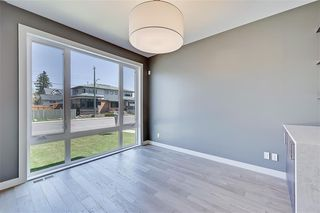 Photo 7: 213 18 Street NW in Calgary: West Hillhurst Semi Detached for sale : MLS®# A1029385