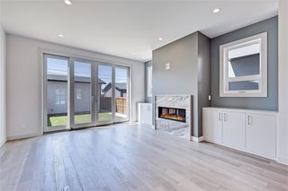 Photo 11: 213 18 Street NW in Calgary: West Hillhurst Semi Detached for sale : MLS®# A1029385