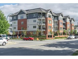 Photo 1: 403 2268 Shaughnessy Street in Port Coquitlam: Central Pt Coquitlam Condo for sale : MLS®# R2270479