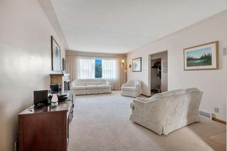 Photo 8: 7827 7 Street SW in Calgary: Kingsland Detached for sale : MLS®# A1030165