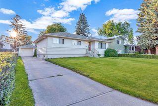 Photo 2: 7827 7 Street SW in Calgary: Kingsland Detached for sale : MLS®# A1030165