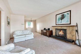 Photo 6: 7827 7 Street SW in Calgary: Kingsland Detached for sale : MLS®# A1030165