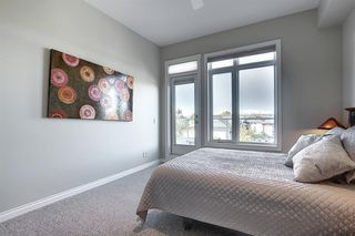 Photo 18: 6401 14 HEMLOCK Crescent SW in Calgary: Spruce Cliff Apartment for sale : MLS®# A1036904
