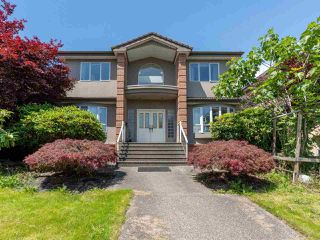 Photo 1: 2387 BONACCORD Drive in Vancouver: Fraserview VE House for sale (Vancouver East)  : MLS®# R2510745