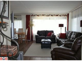 """Photo 1: 273 1840 160TH Street in Surrey: King George Corridor Manufactured Home for sale in """"Breakaway Bays"""" (South Surrey White Rock)  : MLS®# F1212134"""