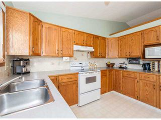 Photo 9: 153 HARVEST OAK Way NE in CALGARY: Harvest Hills Residential Detached Single Family for sale (Calgary)  : MLS®# C3552765