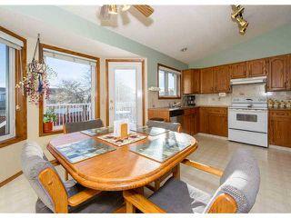 Photo 7: 153 HARVEST OAK Way NE in CALGARY: Harvest Hills Residential Detached Single Family for sale (Calgary)  : MLS®# C3552765