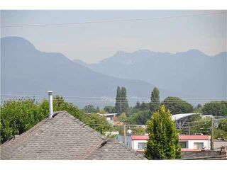Photo 1: 1645 E 14TH Avenue in Vancouver: Grandview VE House for sale (Vancouver East)  : MLS®# V1076055