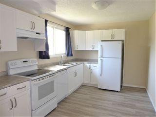 Photo 2: 5627 137 Avenue in Edmonton: Zone 02 Townhouse for sale : MLS®# E4209385
