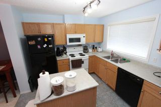 Photo 4: 275 PRESTWICK ACRES Lane SE in CALGARY: McKenzie Towne Townhouse for sale (Calgary)  : MLS®# C3533928