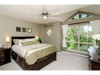 "Photo 1: 29 65 FOXWOOD Drive in Port Moody: Heritage Mountain Townhouse for sale in ""FOREST HILL"" : MLS®# V974038"
