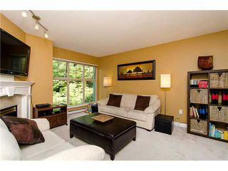 "Photo 3: 29 65 FOXWOOD Drive in Port Moody: Heritage Mountain Townhouse for sale in ""FOREST HILL"" : MLS®# V974038"