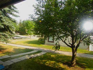 Photo 2: 140 DEER RIDGE Lane SE in CALGARY: Deer Ridge Townhouse for sale (Calgary)  : MLS®# C3629985