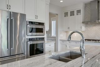 Photo 11: 134 CRANBROOK Circle SE in Calgary: Cranston Detached for sale : MLS®# A1028295