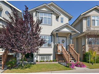 "Photo 1: 121 33751 7TH Avenue in Mission: Mission BC Townhouse for sale in ""Heritage Park Place"" : MLS®# F1418910"