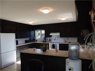 Photo 3: 1318 Murdoch Street: Crossfield Residential Detached Single Family for sale : MLS®# C3629322