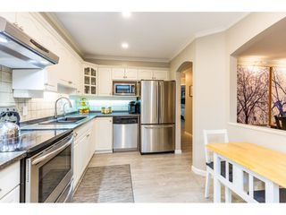 """Photo 9: 107 17727 58 Avenue in Surrey: Cloverdale BC Condo for sale in """"Derby Downs"""" (Cloverdale)  : MLS®# R2411031"""