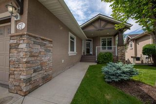 Photo 2: 67 DISCOVERY WOODS Villas SW in Calgary: Discovery Ridge Duplex for sale : MLS®# A1015437
