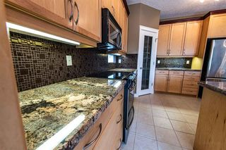 Photo 12: 67 DISCOVERY WOODS Villas SW in Calgary: Discovery Ridge Duplex for sale : MLS®# A1015437