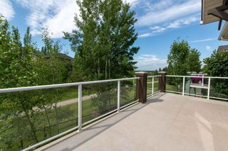 Photo 33: 67 DISCOVERY WOODS Villas SW in Calgary: Discovery Ridge Duplex for sale : MLS®# A1015437