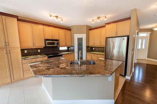 Photo 11: 67 DISCOVERY WOODS Villas SW in Calgary: Discovery Ridge Duplex for sale : MLS®# A1015437