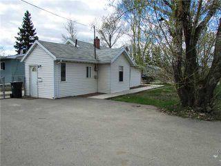 Photo 2: 9715 102ND Street in Fort St. John: Fort St. John - City SW House for sale (Fort St. John (Zone 60))  : MLS®# N227947