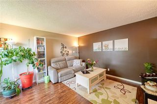 Photo 2: 52 1155 FALCONRIDGE Drive NE in Calgary: Falconridge Row/Townhouse for sale : MLS®# C4300949