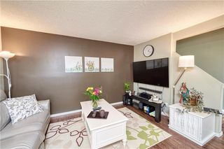 Photo 5: 52 1155 FALCONRIDGE Drive NE in Calgary: Falconridge Row/Townhouse for sale : MLS®# C4300949