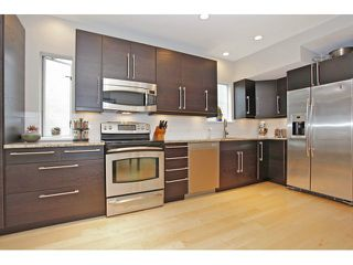 Photo 1: 450 W 15TH AV in Vancouver: Mount Pleasant VW Townhouse for sale (Vancouver West)  : MLS®# V1015550