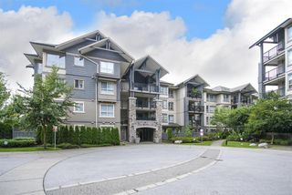 Photo 1: 104 2958 WHISPER WAY in Coquitlam: Westwood Plateau Condo for sale : MLS®# R2099902
