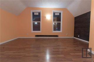 Photo 2: 122 Aikins Streets in Winnipeg: Duplex for sale (4A)  : MLS®# 1910102
