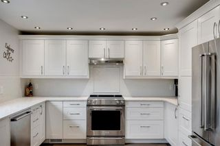 Photo 15: 315 Queen Charlotte Place SE in Calgary: Queensland Detached for sale : MLS®# A1042205