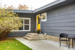Photo 2: 315 Queen Charlotte Place SE in Calgary: Queensland Detached for sale : MLS®# A1042205