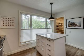 Photo 6: 13 POINT MCKAY Court NW in Calgary: Point McKay Row/Townhouse for sale : MLS®# C4299919