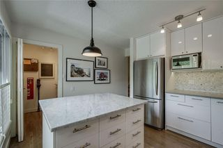 Photo 8: 13 POINT MCKAY Court NW in Calgary: Point McKay Row/Townhouse for sale : MLS®# C4299919