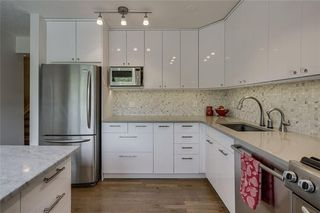 Photo 9: 13 POINT MCKAY Court NW in Calgary: Point McKay Row/Townhouse for sale : MLS®# C4299919